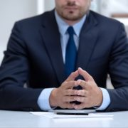 Confident lawyer attentively listening to client, legal problems solution