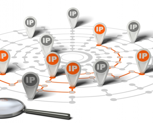 Many flags withe the word IP pined on network over white background and a magnifier. Concept image for illustration of IP tracking.