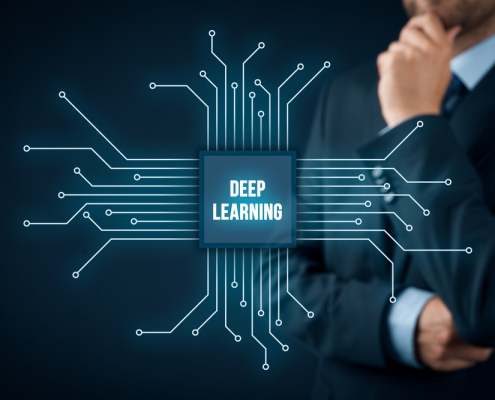 Deep structured learning, hierarchical learning or deep machine learning concept - learning methods based on learning representations of data. Businessman or programmer with abstract symbol of a chip with text deep learning connected with data represented by points.